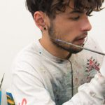 Gavin painting with oil paints in the studio.