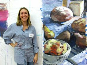 Student with large still life of food